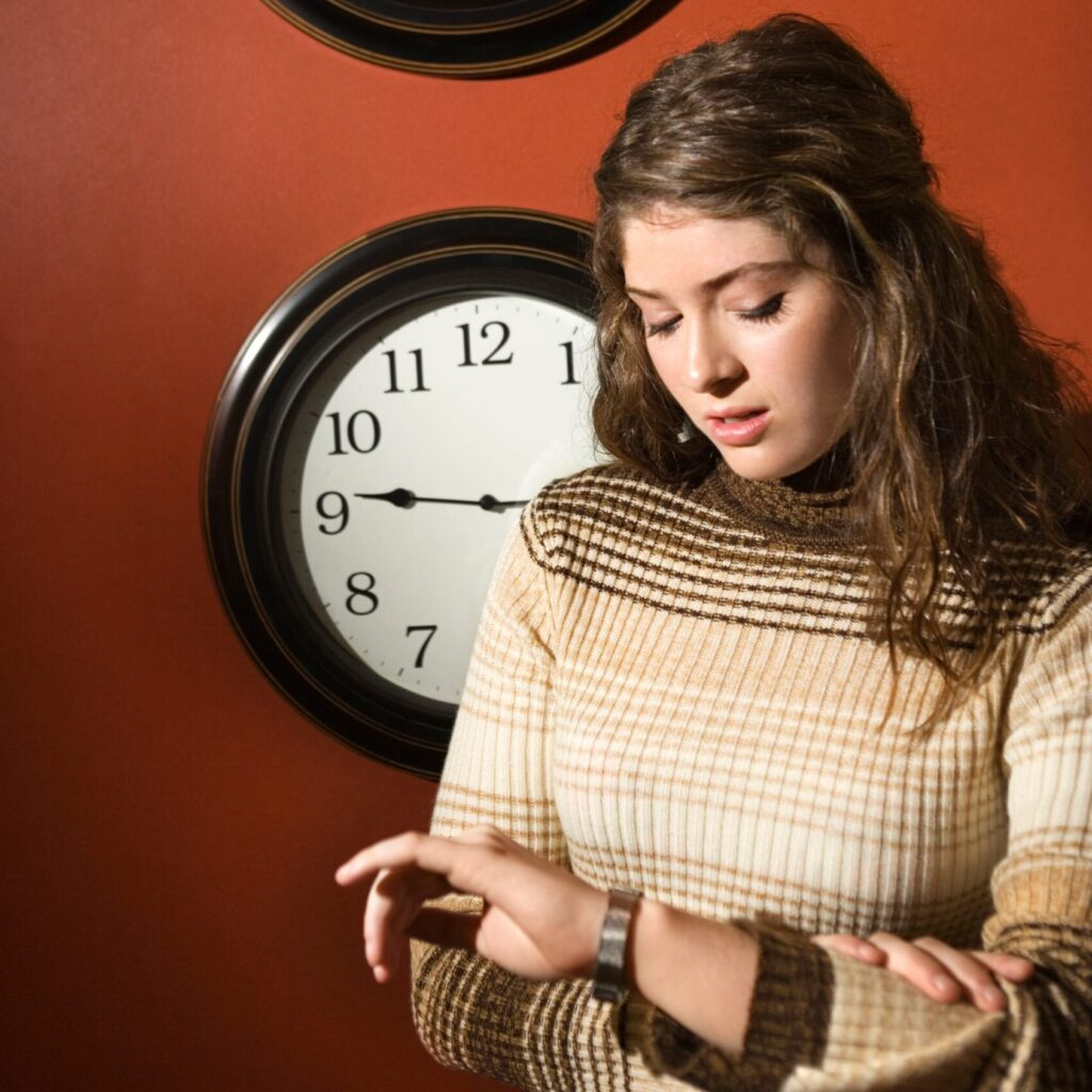 Woman stressed for time-min